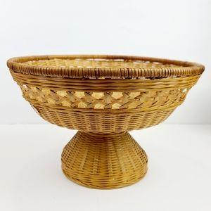 Vintage pedestal wicker basket